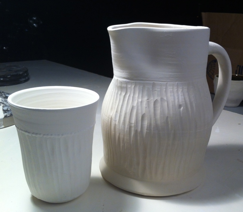 carved pitcher and cup